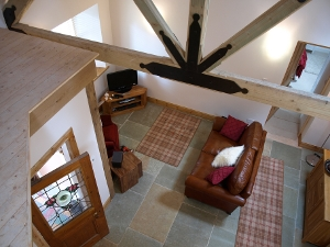 Living room accommodation in Aros Beag, Tyndrum. A beautiful self catering holiday cottage by the River Fillan